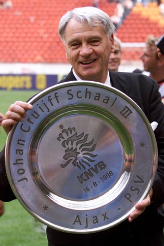 PSV Eindhoven's coach Bobby Robson holds up the trophy after winning the Dutch Super Cup [against Ajax] in Amsterdam.