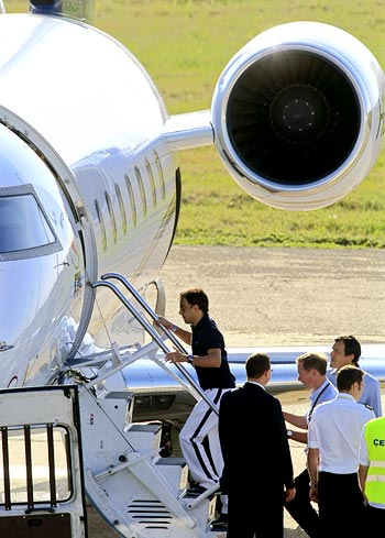 Massa prepares to depart on a private jet to Brazil at Budapest airport after being released from hospital