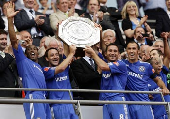 Chelsea's Didier Drogba, John Terry. Frank Lampard and Ricardo Carvalho celebrate with the trophy