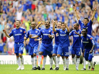 Chelsea players celebrate their triumph