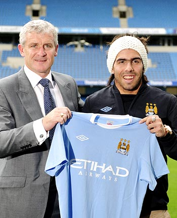 Manchester City striker Carlos Tevez (right) with manager Mark Hughes