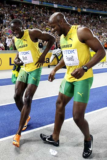 Usain Bolt (left) celebrates the victory with compatriot Asafa Powell