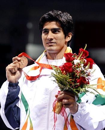 Vijender Kumar shows off the bronze medal during the medal ceremony at the Beijing 2008 Olympic Games