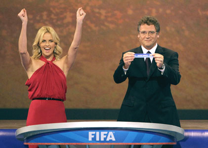 South African actress Charlize Theron cheers as FIFA general secretary Valcke announces the name of South Africa during the World Cup draw on Friday