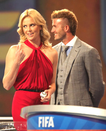 Charlize Theron and English footballer David Beckham during the 2010 World Cup draw in Cape Town on Friday