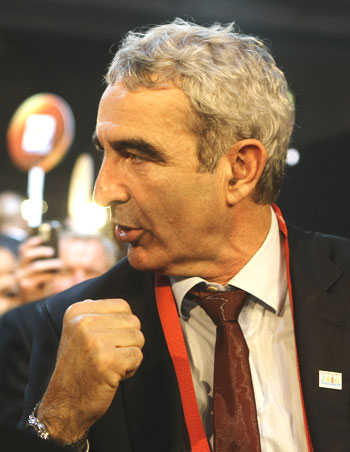 France's coach Raymond Domenech gestures before the 2010 World Cup draw in Cape Town on Friday