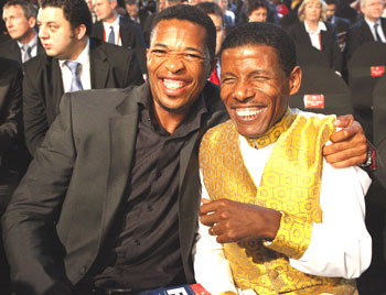 South African cricketer Makhaya Ntini (left) and Ethiopian runner Haile Gebrselassie shares a laugh before the 2010 World Cup draw in Cape Town on Friday