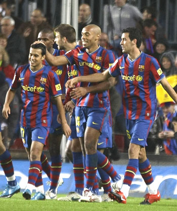 Barcelona's Thierry Henry (centre) with team-mates