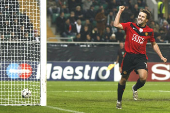 Manchester United's Michael Owen celebrates after scoring against VfL Wolfsburg