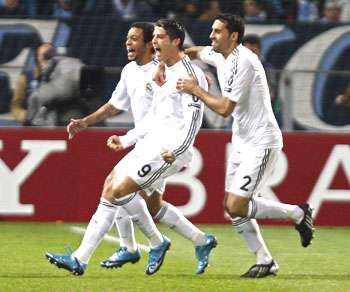Real Madrid's Ronaldo (centre) celebrates with team-mates after scoring against Olympique Marseille