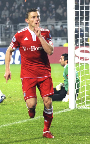 Bayern Munich's Ivica Olic celebrates after scoring past hapless Juventus 'keeper Gianluigi Buffon