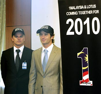 Lotus F1 drivers Jarno Trulli (right) and Heikki Kovalainen