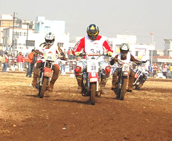 Freddy Elavia (centre) rides past Anish Nair (left) and Kallil Premjith