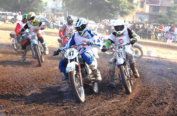 V Kurup (left), K Shukla, A Virkud (extreme left) negotiate a gravel-laden course in Novice class