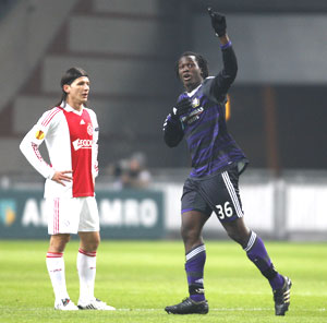 Anderlecht's Romelu Lukaku (right) celebrates his first goal as Ajax Amsterdam's Marko Pantelic puts on a grim look during their Europa League tie on Thursday
