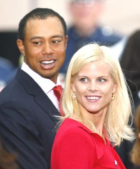 Tiger Woods with wife Elin Nordegren
