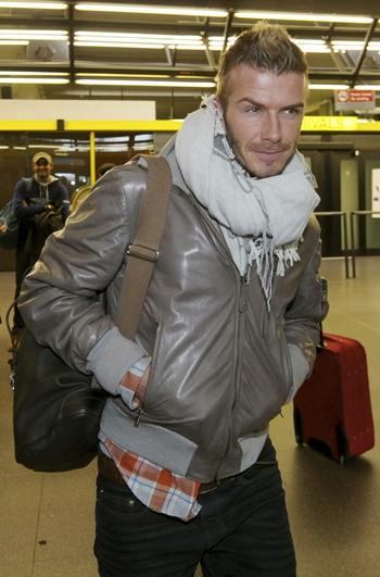 David Beckham arrives at Malpensa airport around 40 km northwest from Milan