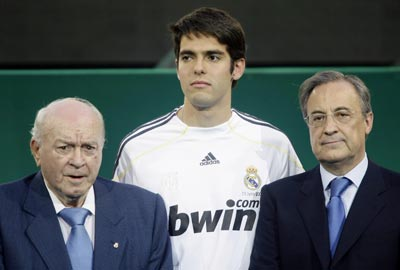 Kaka is seen with Real president Florentino Perez (left) and honorary president Alfredo di Stefano