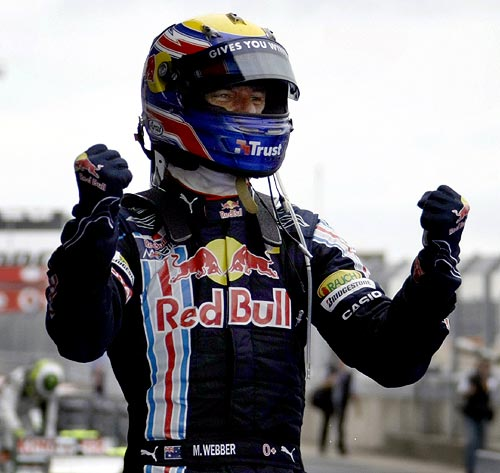 Red Bull driver Mark Webber of Australia celebrates his victory in the German F1 Grand Prix