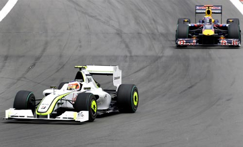 Image: Rubens Barrichello (left) drives in front of Red Bull's Mark Webber