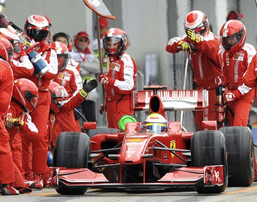 Felipe Massa receives a new set of tyres during a pit stop