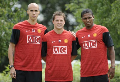 (from left to right) Manchester United's new signings Gabriel Obertan, Michael Owen and Antonio Valencia pose for photographs at the clubs Carrington training centre in Manchester