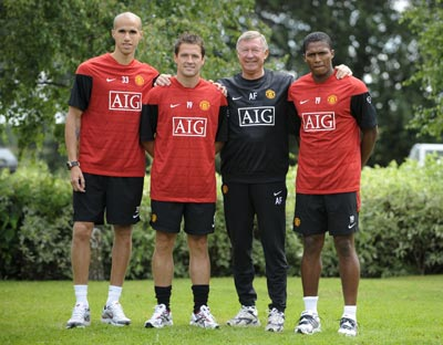 Manchester United's new signings Gabriel Obertan (left), Michael Owen and Antonio Valencia (right) pose for photographs with coach Alex Ferguson at the clubs Carrington training centre in Manchester