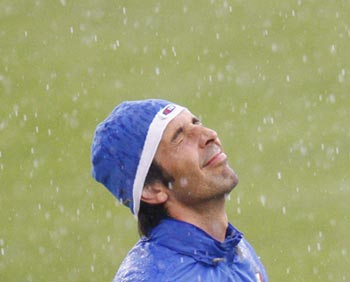 Italian soccer goalkeeper Gianluigi Buffon enjoys a passing shower