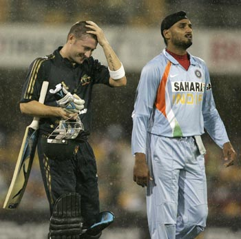 Michael Clarke and Harbhajan Singh walk off the field after rain ended play, Brisbane, February 2008