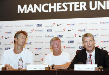 Manchester United's Chief Executive David Gill (right) speaks as manager Alex Ferguson (centre) and goalkeeper Edwin Van der Sar listen during a news conference at a hotel in Seoul on Thursday.