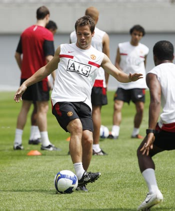 Manchester United's Michael Owen dribbles the ball during a training session at Seoul.