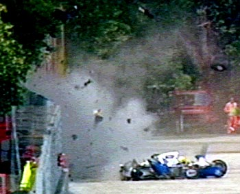 Wreckage from Ayrton Senna's car flies through the air at the San Marino Grand Prix on May 1, 1994
