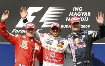 Race winner Lewis Hamilton (centre) with Raikkonen and Red Bull's Mark Webber on the podium