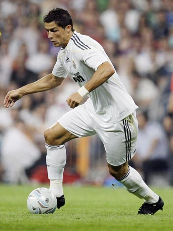 Real Madrid's Cristiano Ronaldo controls the ball during their Peace Cup match against Al Ittihad in Madrid