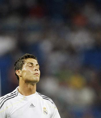 Real Madrid's Cristiano Ronaldo reacts during their Peace Cup match against Saudi Arabia's Al-Ittihad in Madrid