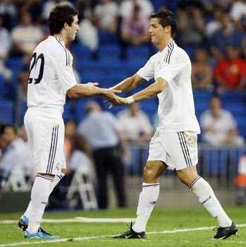 Real Madrid's Cristiano Ronaldo shakes hands with Higuain as he leaves the pitch during their Peace Cup match in Madrid