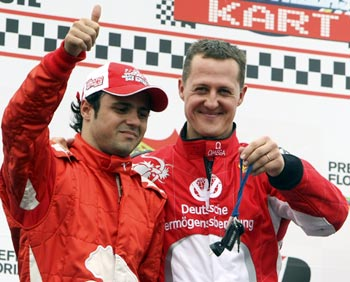 Michael Schumacher (right) with Felipe Massa