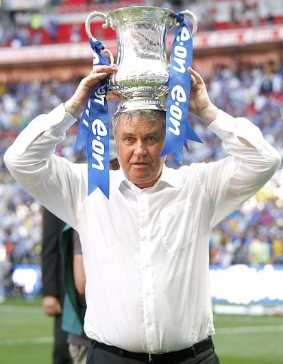 Chelsea's manager Guus Hiddink holds the trophy after their English FA Cup final win on May 30, 2009