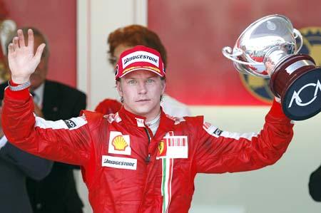 Kimi Raikkonen celebrates after taking the third place in the Monaco Grand Prix on May 24, 2009
