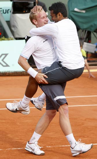 Leander Paes of India and Lukas Dlouhy of the Czech Republic celebrate after winning the final
