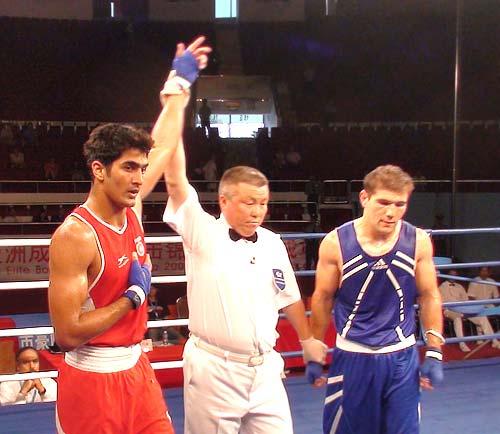 Vijender Singh beat Atoev Abbos