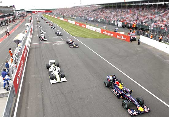 Cars take off at the start of the British Grand Prix