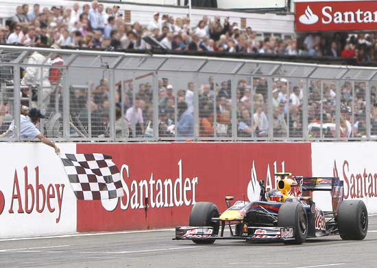 Sebastian Vettel crosses the finish line to win the British Grand Prix