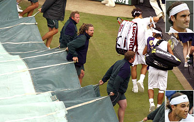 Roger Federer and Rafael Nadal walk off court after rains interrupted the Wimbledon 2008 final