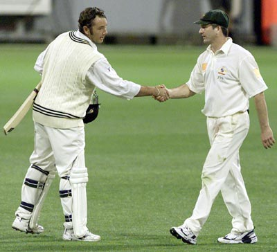 Craig McMillan and Steve Waugh at the end of the Brisbane Test.