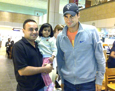 Roger Federer with Mitesh and his daughter Natasha
