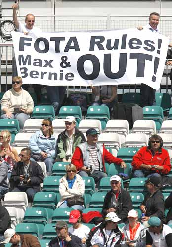 Fans hold up a banner against F1's commercial supremo Bernie Ecclestone and FIA President Max Mosley at Silverstone