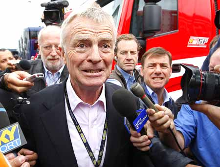 FIA President Max Mosley surrounded by reporters