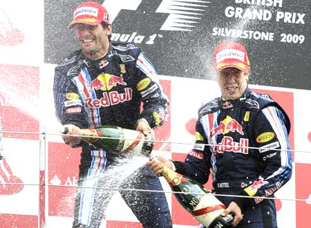 Red Bull driver Sebastian Vettel (right) celebrates winning the British Grand Prix with teammate Mark Webber