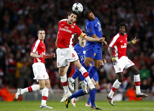 Arsenal captain Cesc Fabregas (left) and Anderson of Manchester United